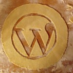 The WordPress logo cut into pie crust dough.
