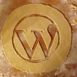 The WordPress logo cut into pie crust dough.