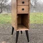 """A 31"""" tall, 9"""" wide, 18"""" deep nightstand made of red oak."""